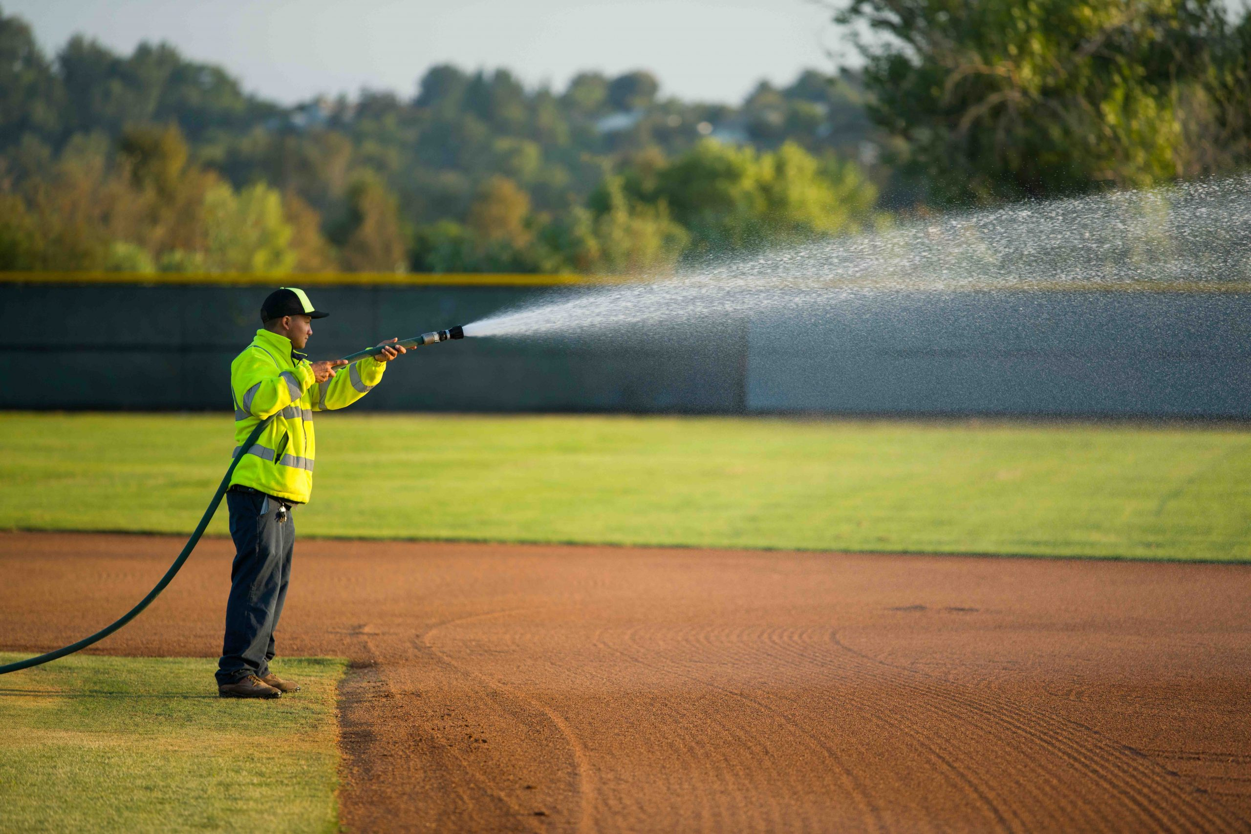 Man watering the park